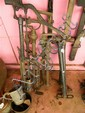 A FE Myers & Bros pump together with four similar brass pumps and three air pumps