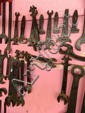 Twenty assorted open ended and ring spanners and adjustable wrenches, some marked NSW13