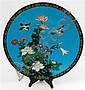 A Japanese Cloisonne Blue dish with two plovers hovering above a flower garden. Taisho Period 20th century.