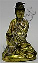 A Seated Gilt Bronze Figure of Guanyin, with a poised calm, her hair inlaid with a gilt adornment & the top knot with a pin.