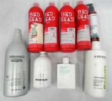 A large bag of shampoos & Conditioners