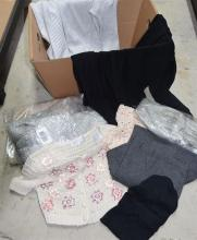A box of assorted knitwear