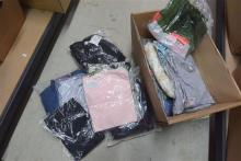 A box of ladies packaged clothes
