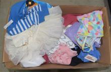 A box of baby clothes & accessories