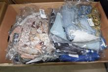 A box of assorted ladies packaged clothes