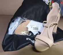 A pair of womens block heels marked Spurr size 10