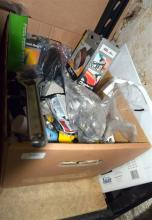 A box of assorted hardware lines & tools
