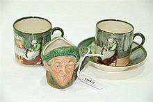 A Royal Doulton coffee cup and saucer, D4570, together with spare cup and miniature character jug