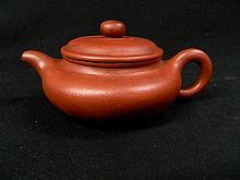 A Chinese pottery tea pot