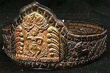 A Vietnamese/ Cham bronze crown with gilt centre