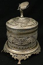 A 20th century Thai silver repousse lidded bowl on silver footed stand