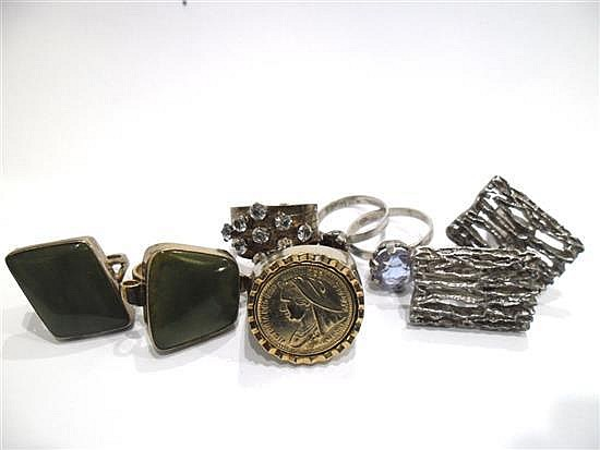 six silver and gold plated rings together with a pair of sil