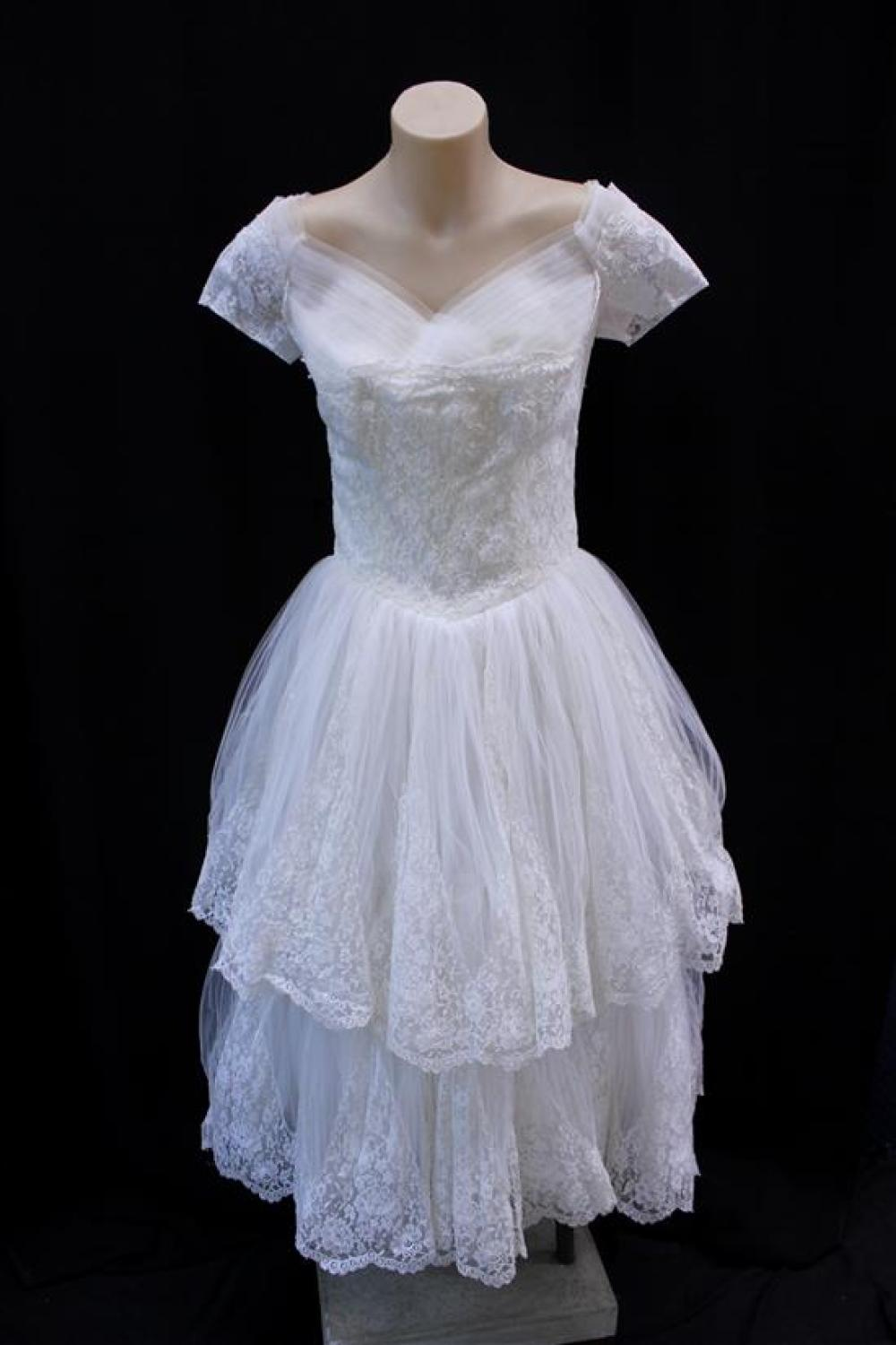 An Ivory Silk Tulle & Silk Chantilly Lace Cahill of Beverly Hills Wedding Dress,