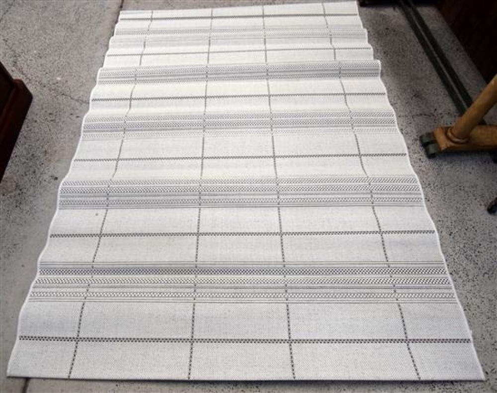 A Synthetic Flatweave Rug in White/Black