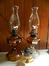 Two glass kerosene lamps