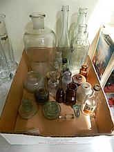 A box of various bottles and inkwells