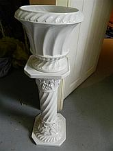 A white ceramic planter and pedestal set