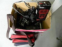 A box of assorted camera equipment
