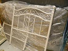 A white metal single bed frame