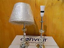 A pair of chrome and glass bedside lamps
