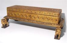 A Burmese Lacquer & Gilt Lidded Box, the Long Rectangular Shape is Encrusted with Foiled Mirror Glass, 19th Century,