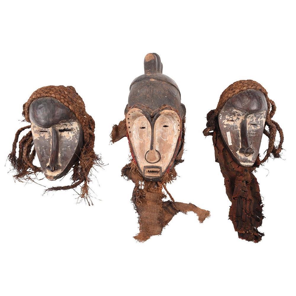 Five West African Carved and Polychromed Masks