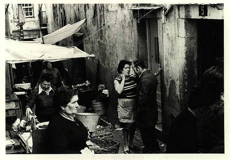 Bot, M. (b.1946). (Couple in a narrow Lisbon market street). Gelatin silver