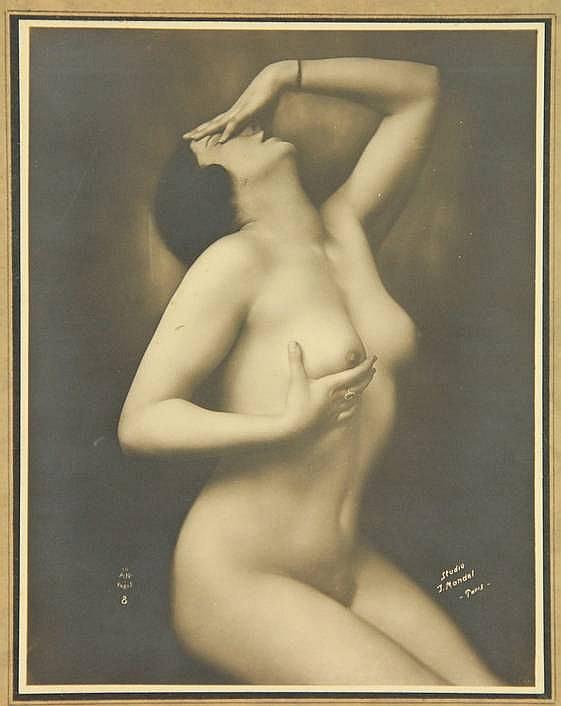 Mandel, J. (1872-1935). (Female nude holding her right breast). Gelatin silver print, 21,9x17 cm.,