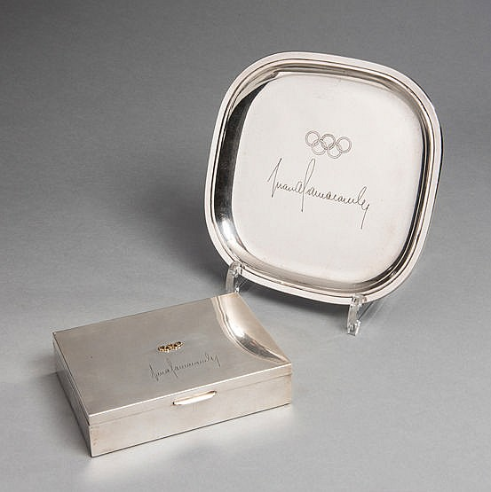 A dish and a cigarette box engraved with the signature of the IOC Pres