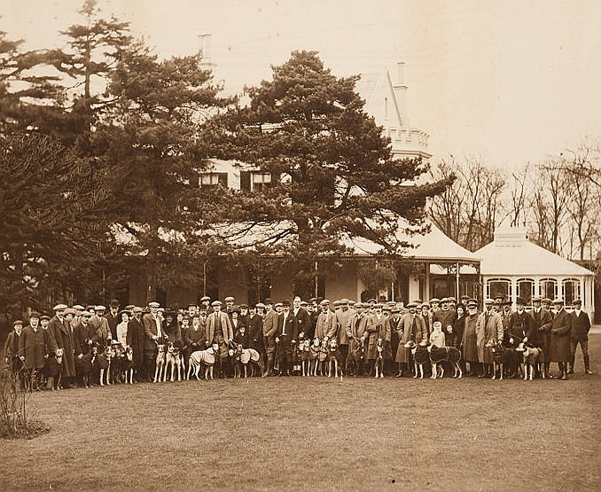 Large mounted photograph of a hare coursing meeting, portraying a lar