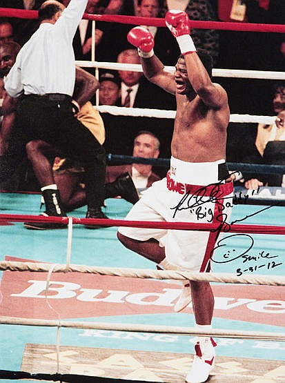 Photographs signed by the boxers Riddick Bowe, Tim Witherspoon & Buste