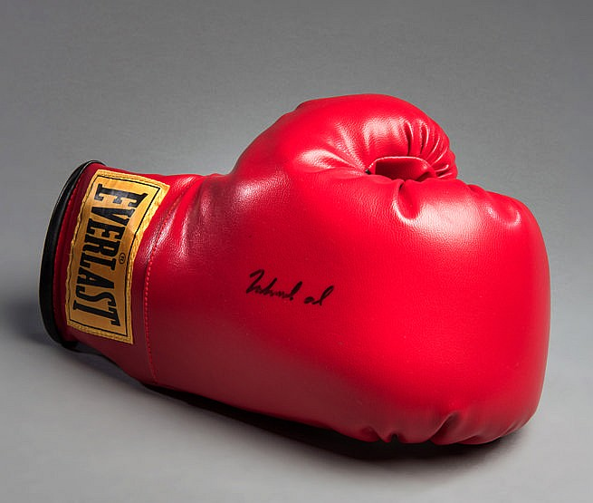 A Muhammad Ali signed boxing glove, a right-hand red Everlast glove,