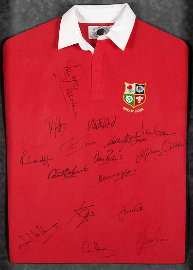 A signed Dream Lions rugby shirt, signatures in black marker pen, com