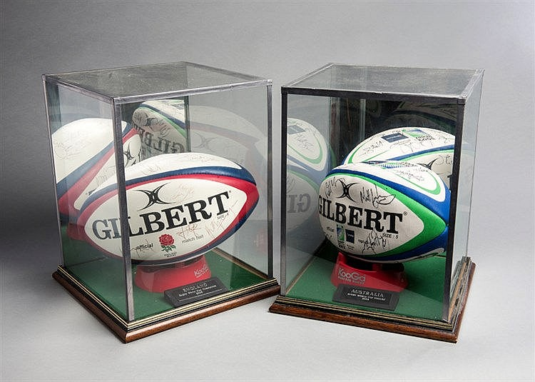 A pair of autographed Gilbert rugby balls signed by the England and Au