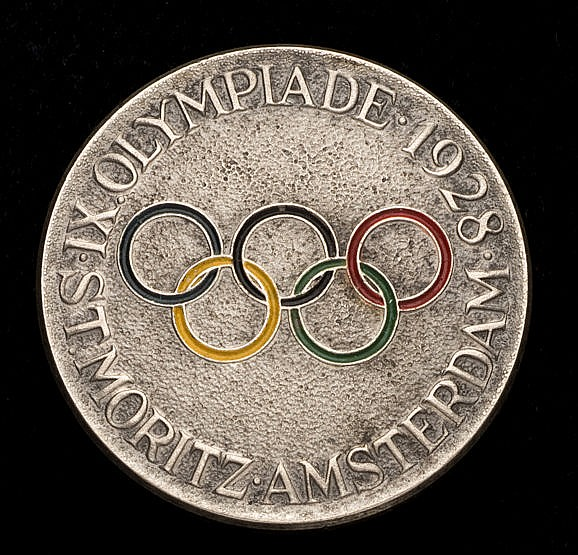 Olympic lapel badge for the winter and summer games of 1928, Silvered