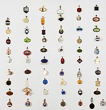 A collection of racing badges for British racecourses,  mounted onto a