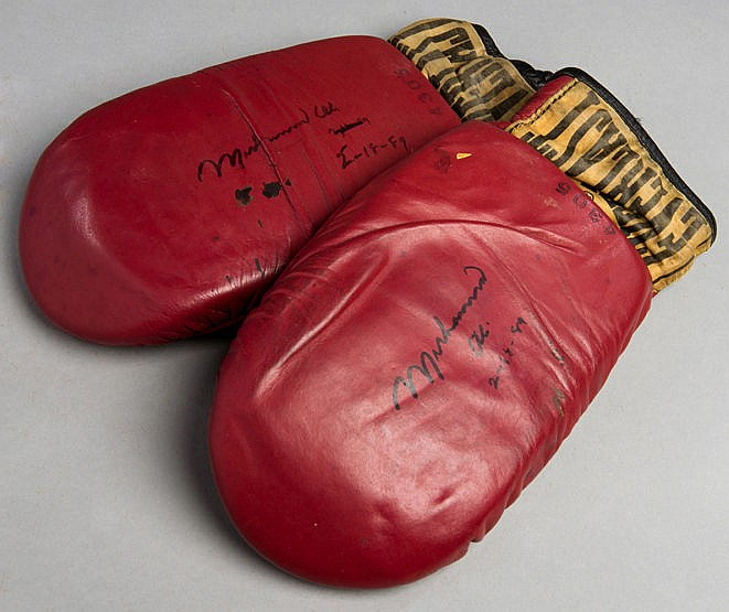 Muhammad Ali signed pair of Everlast sparring mitts,  both signed and