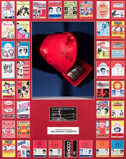 A Sir Henry Cooper signed boxing glove presentation,  a left-hand red