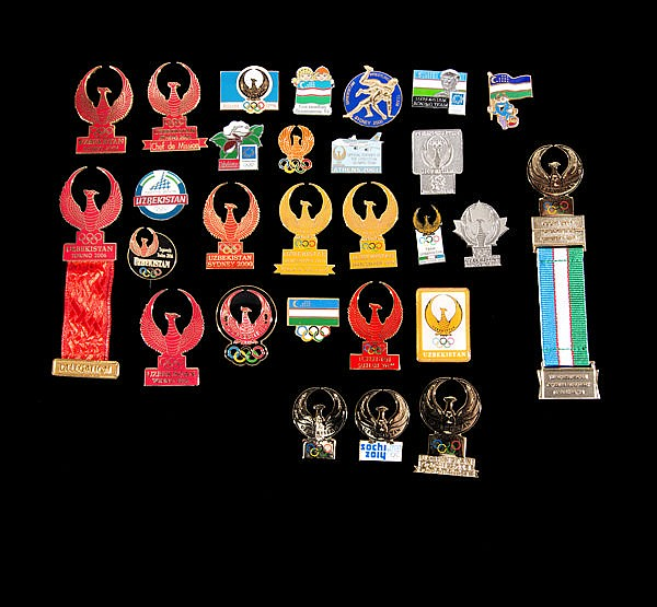 A set of 28 official Uzbekistan team pins covering the Olympic Games f