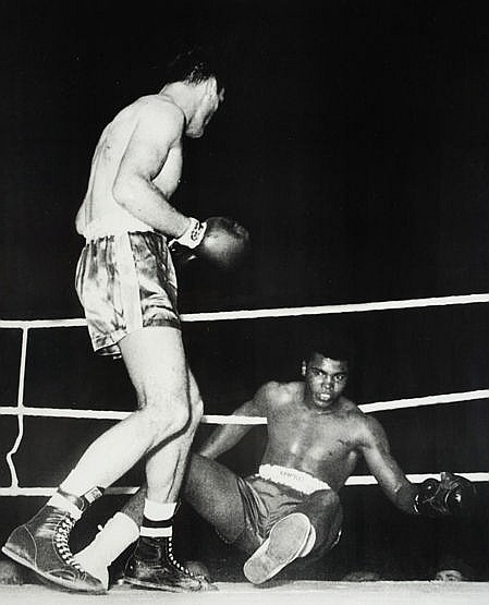 Henry Cooper signed photographic print, b&w; showing his opponent Cass