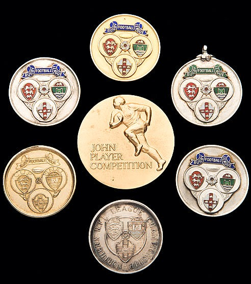 A group of seven rugby league medals awarded to the Hull player Mick C