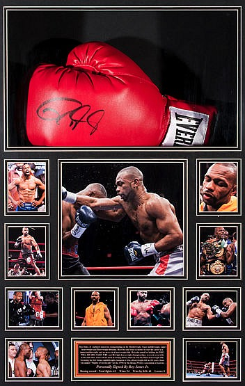 A signed Roy Jones Jr. boxing glove presentation,  a left-hand red Eve