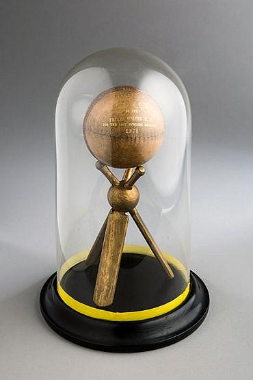 An 1878 presentation cricket ball, the ball inscribed gilt PRESENTED