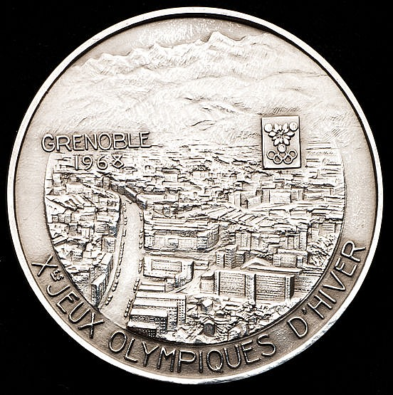 A Grenoble 1968 Winter Olympic Games participant's medal,  In silvered