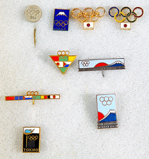 Nine Tokyo 1964 Olympic Soviet commemorative pins, all but one enamel