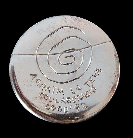 A Barcelona 1992 Olympic Games participant's medal,   designed by Xavi