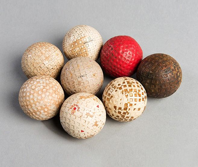 Eight golf balls, including a square-mesh Redwing golf ball circa 192