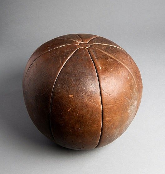 A 19th century leather gymnasium medicine ball, eight panels and butt