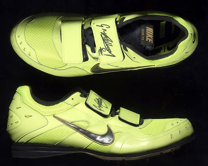 A signed pair of Greg Rutherford worn long jump spikes,  a pair of yel