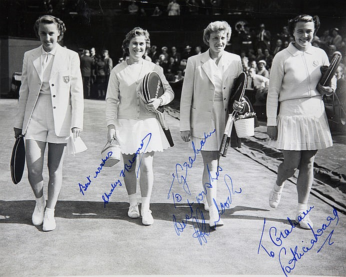 Signed original press photograph of the ladies doubles players at the